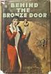 Behind the Bronze Door